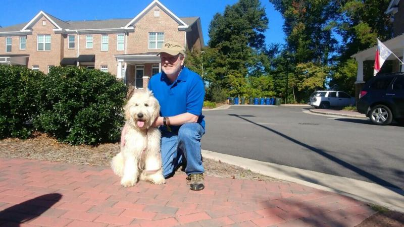 Phil Berger with his dog, Obi. The Rockingham County Republican is the president of the NC Senate, and the most powerful official in NC politics.