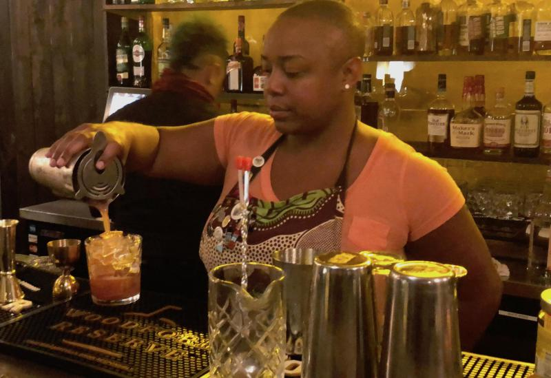 Mixologist and cocktail historian Tiffanie Barriere makes a Bizzy Izzy at Twisted Soul Cookhouse & Pours in Atlanta.. She appears on The Bitter Southerner Podcast to talk about the influence of African Americans on Southern cocktails.