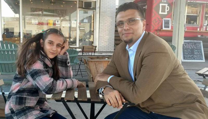 Nawroz Youssef and Heval Kelli sitting at a table.