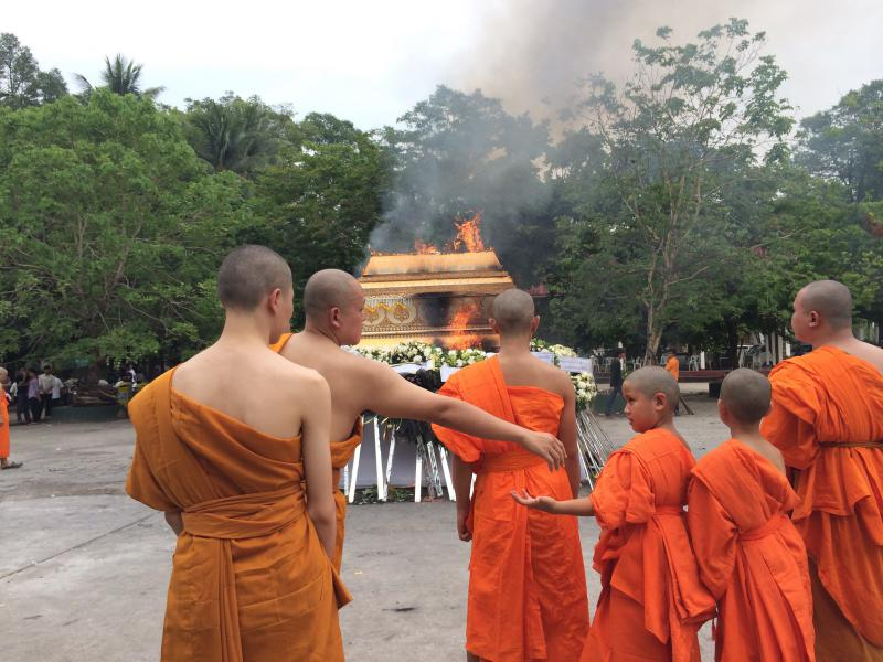 Following Laotian tradition, Vansana and his brother became Buddhist monks for their grandmother's funeral.