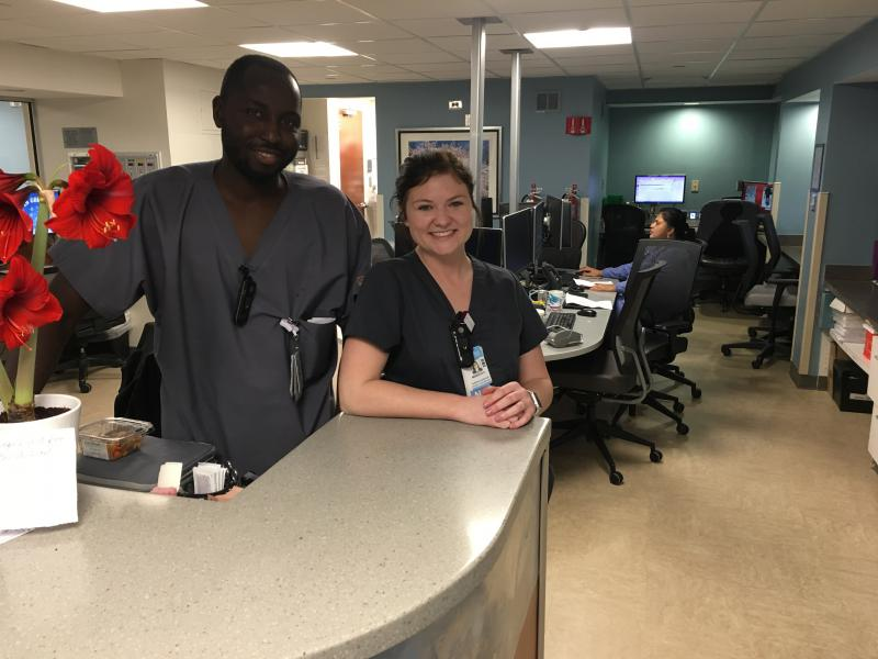 Meredith Pounds with her colleague Lamin Sanneh on the fourth floor of UNC Rex Hospital