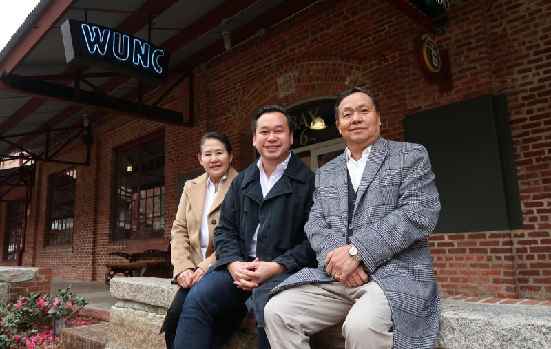 Vansana Nolintha (center) outside of the WUNC studios with his parents on a rare family visit to the U.S.