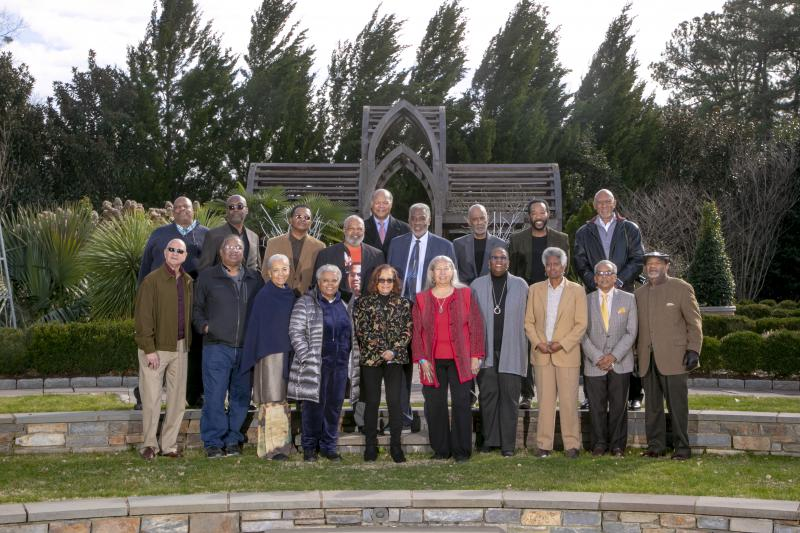 A group photo of many of the original Allen Building protesters who returned for a weekend commemoration outside of the Doris Duke Center at the Sarah P. Duke Gardens.