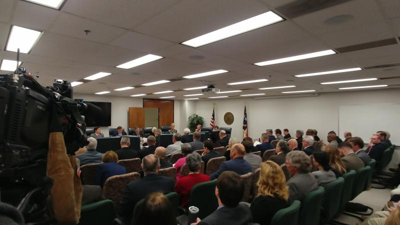 The 10-member Council of State gathered Tuesday for its regular meeting, but postponed a decision on moving the DMV headquarters to Rocky Mount.