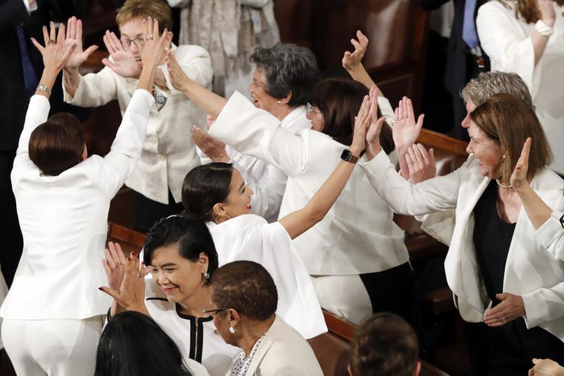 Women members of Congress, including Rep. Alexandria Ocasio-Cortez, D-N.Y., center, cheer after President Donald Trump acknowledges more women in Congress during his State of the Union address to a joint session of Congress on Capitol Hill in Washington.