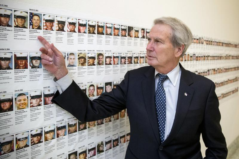 U.S. Rep. Walter Jones, R-N.C., points at a photograph of Marine Sgt. Michael Edward Bits of Ventura, Calif., the first military funeral he and his wife attended,