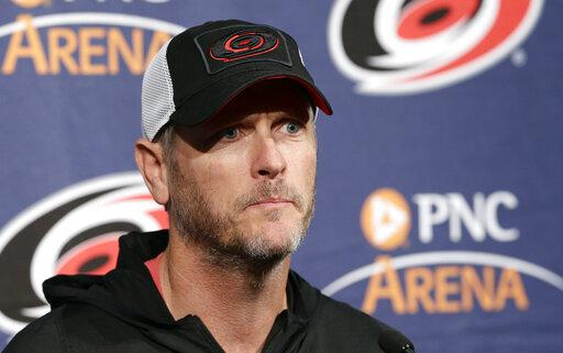 In this May 9, 2018, file photo, Carolina Hurricanes owner and CEO Tom Dundon takes questions during an NHL hockey news conference in Raleigh.
