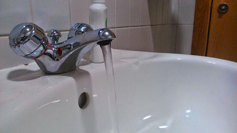 A picture of a running tap.