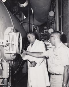 George Bond and Walter Mazzone inspect the outside of a chamber.