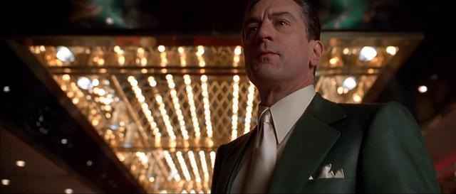 Robert DeNiro in a suit in a casino