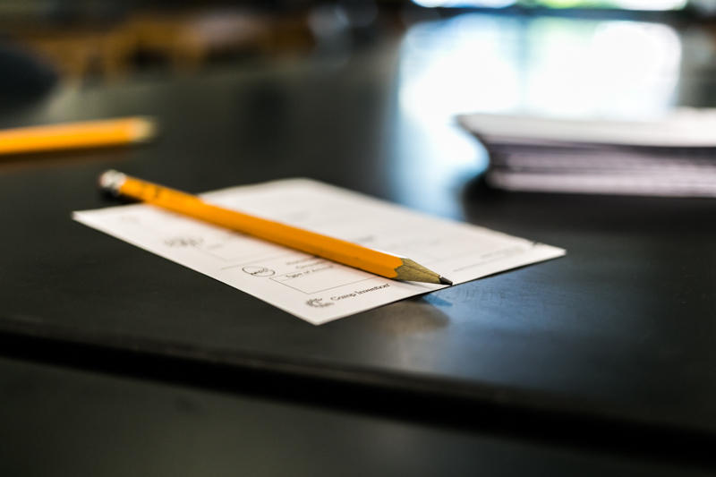 A pencil and a form on a table inside a public school in Durham.