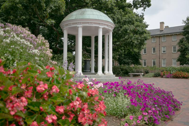 The Old Well and flowers on the campus of UNC- Chapel Hill.
