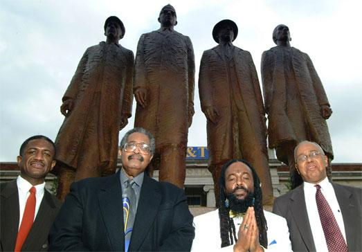 """Left to right: David """"Chip"""" Richmond (son of the late David L. Richmond), Franklin McCain Sr. '63, Jibreel Khazan '63 & Joseph A. McNeil '63, standing in front of the statue commemorating the A&T Four."""