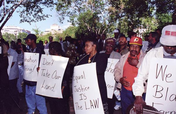 Black farmers protest at Lafayette Park across from the White House in Washington, D.C. on September 22, 1997. Protesters alleged the U.S. Department of Agriculture (USDA) denied black farmers equal access to farm loans and assistance based on their race. North Carolina farmer Timothy Pigford and 400 other black farmers filed the Pigford v. Glickman (Pigford I) class-action lawsuit against USDA in 1997. The USDA settled Pigford I in 1999.