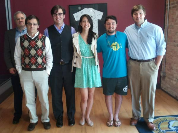 Staffers from Carolina Connection, a student-run radio program, present the work on the State of Things.  From left: Instructor Adam Hochberg, Wesley Graham, Mike Rodriguez, Kirsten Chang, James Kaminsky, and Mark Haywood.