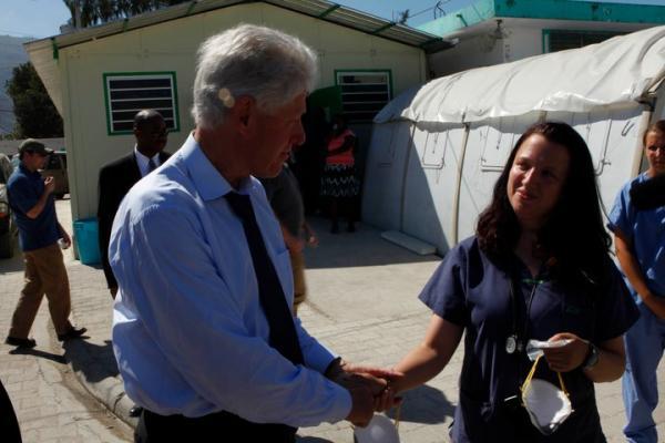President Bill Clinton meets Dr. Megan Coffee in Haiti