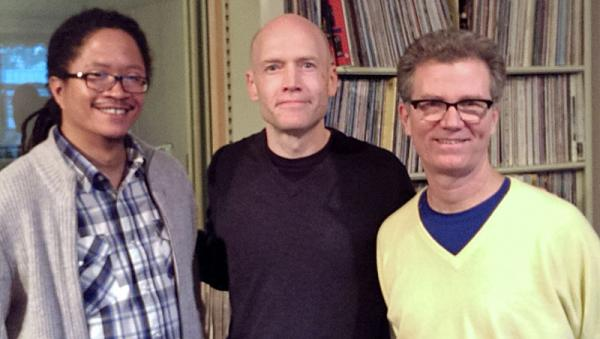 Lem Butler (left) of Counter Culture Coffee and Robbie Roberts (right) of Joe Van Gogh pose for a photo with WUNC Morning Edition Host Eric Hodge.