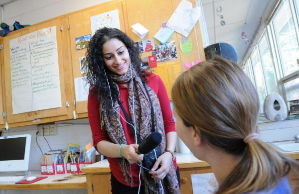WUNC's Reema Khrais talks with a teacher at Glenwood Elementary in Chapel Hill