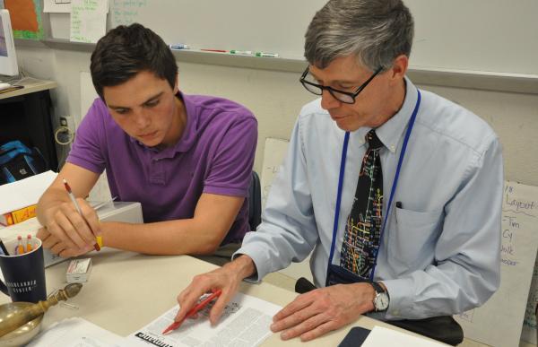 Riverside High School senior Cameron McNeill and math teacher/school paper adviser Steven Unruhe