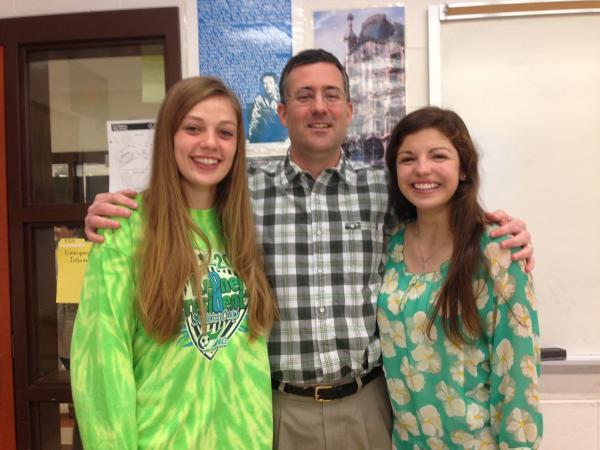 Carrboro High School junior Anna Knotek, history teacher Matthew Cone, and junior Maddie Macmillan