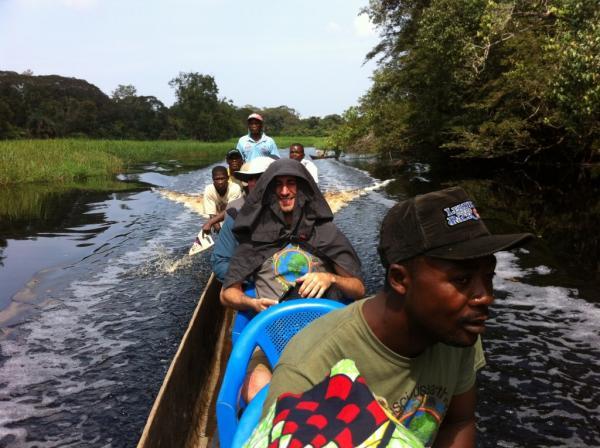 Godi Godar traveling to his ancestral village in DRC by canoe