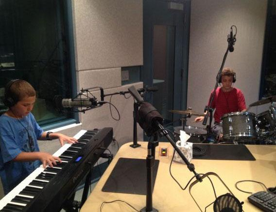 We captured this image of the Bucket Brothers during mic check at the WUNC studios. June, 2014