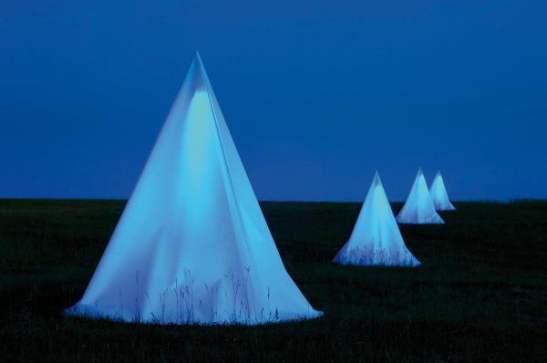 The teepee-like structures are installed with black-ultraviolet/white fluorescent lights, wood, fabric, and invited insects. Each is 2.5 by 1.5 meters.
