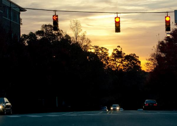 Photo: A four-way highway intersection at sunset