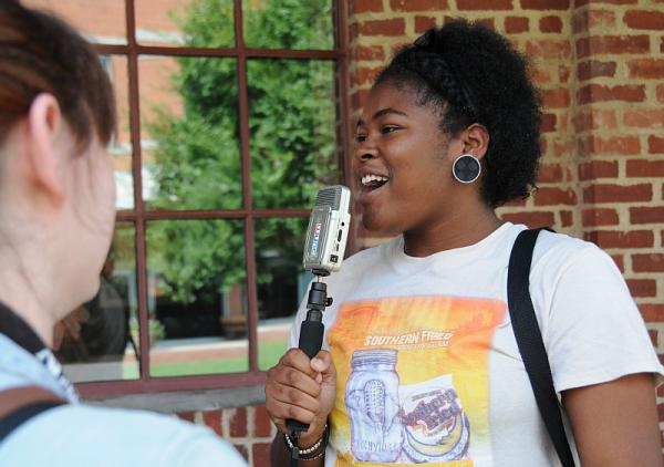 Jamayah Parrish conducting an interview outside the WUNC Studios in Durham