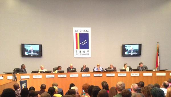 Photo: Rows of people, the Durham City Council and Durham City Manager Tom Bonfield