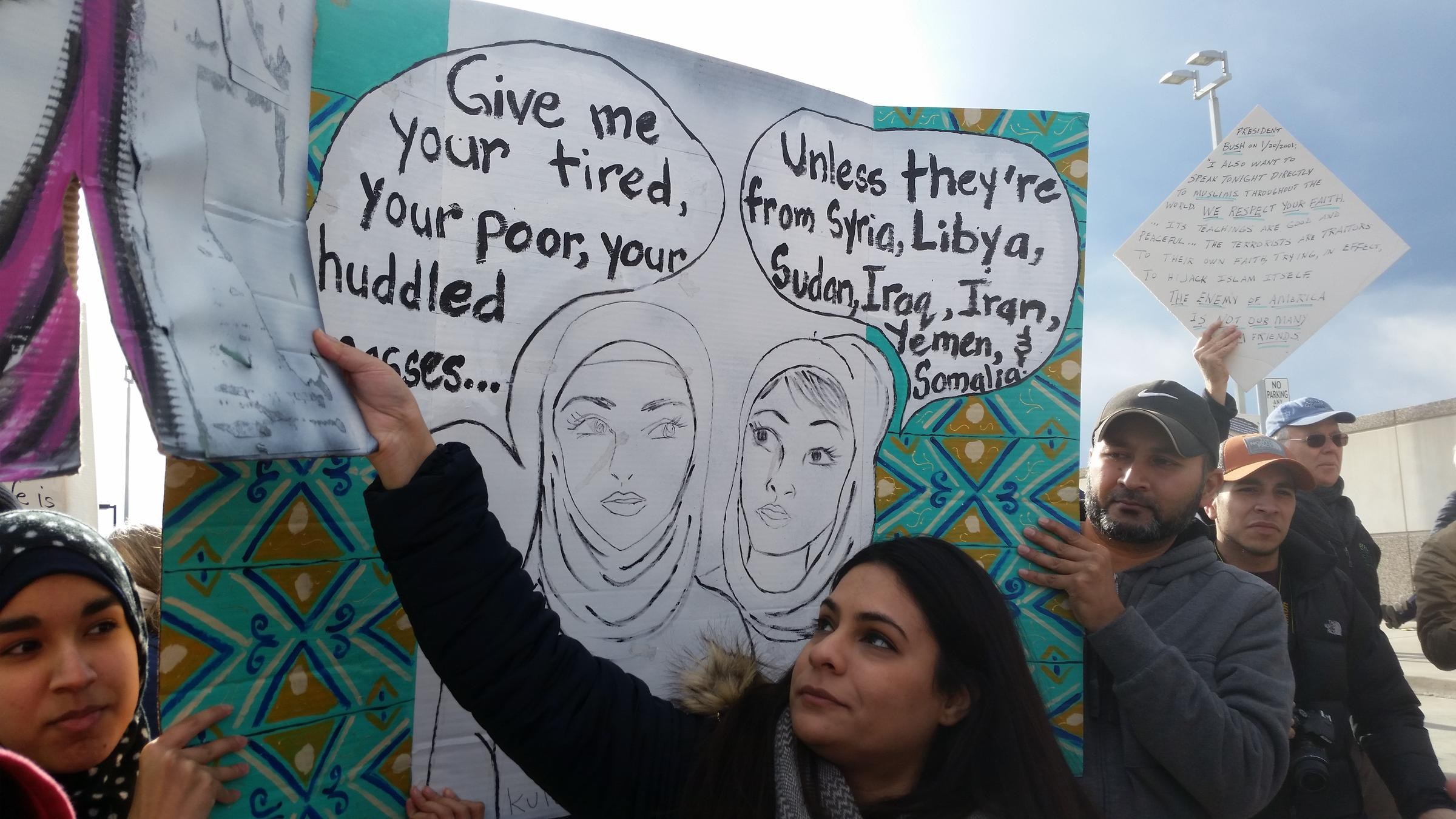 Protesters at RDU Airport demonstrate against President Donald Trump's temporary freeze on immigration from seven majority-Muslim countries.