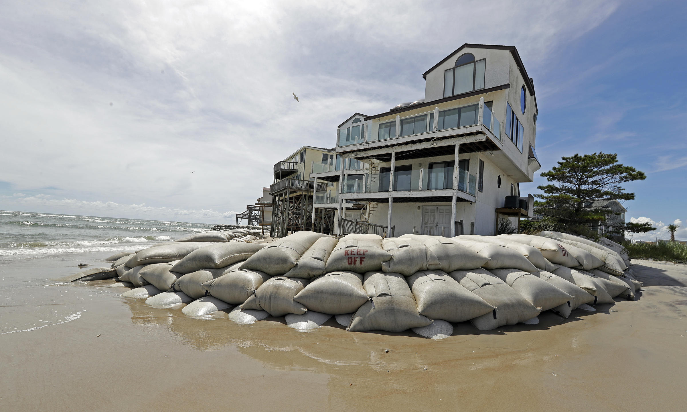 Sand bags surround homes on North Topsail Beach N.C. Wednesday Sept. 12 2018 as Hurricane Florence threatens the coast