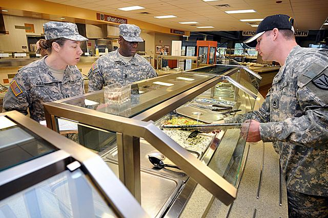 Capt. Laura Malone, a nutritionist, and Sgt. Maj. Ricky Gaines inspect the salad bar at Joint Base Lewis-McChord near Tacoma, Washington.