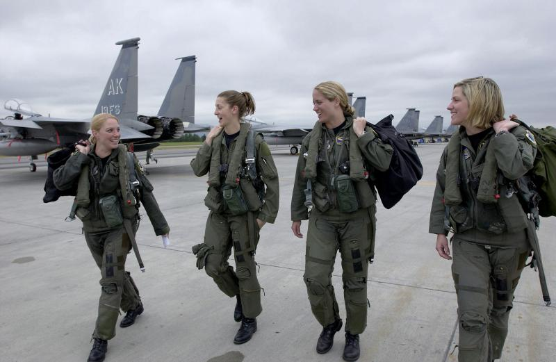 Four F-15 Eagle pilots from the 3rd Wing walk to their respective jets at Elmendorf Air Force Base, Alaska