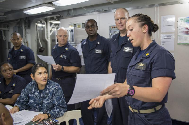 Navy Lt. Jessica Vaeth assists fellow sailors on the Navy assault ship USS Bonhomme Richard register for absentee ballots for the 2016 election.