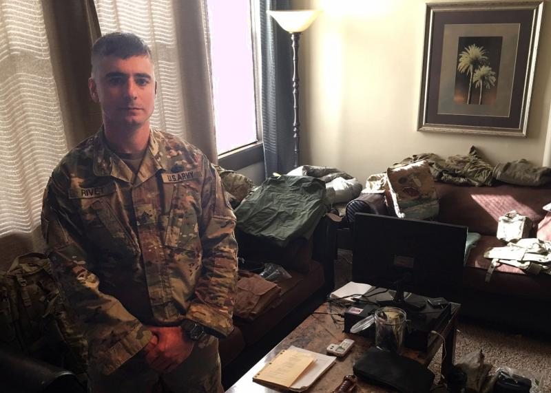 In his Fayetteville, N.C. apartment, Sgt. Nathaniel Rivet prepares to pack his his gear for a nine-month deployment to Iraq.