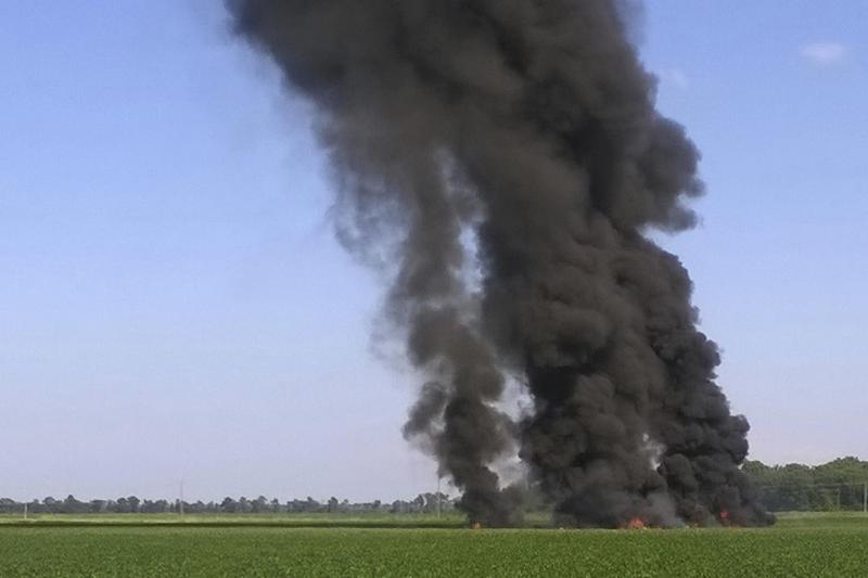 Smoke and flames rise after a military transport plane crashed in a field near Itta Bena, Miss. Monday.