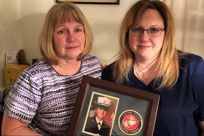 Deana Martorella Orellana's mother, Laurel Martorella (left), and Orellana's sister, Robin Jewell, hold her Marine Corps photo. Orellana killed herself a year after leaving the Marines. She had agreed to undergo counseling the day she died.