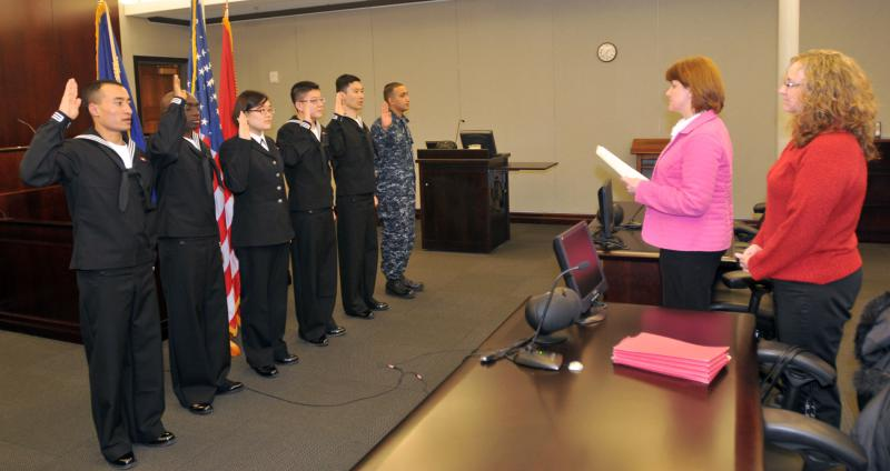 The first Navy sailors to participate in the MAVNI program take their oath of citizenship in this 2010 file photo. MAVNI has been controversial since it began in 2008.