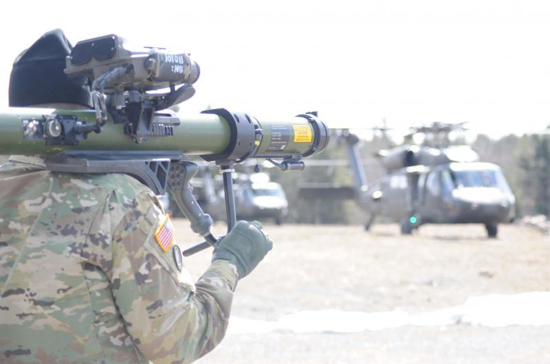 During an Army training exercise, Capt. Fazari Mutalib demonstrates a laser system that tests aviators' abilities to avoid detection.
