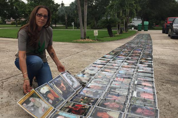 Janine Lutz displays her Memorial Wall, which she built with photos of veterans who killed themselves. She said the VA's policy shunning medical marijuana is leading to needless deaths.