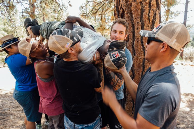 Jesus Guzmán (right) and fellow Higher Ground veterans participate in a team-building exercise during a hike in Big Bear, Cal.