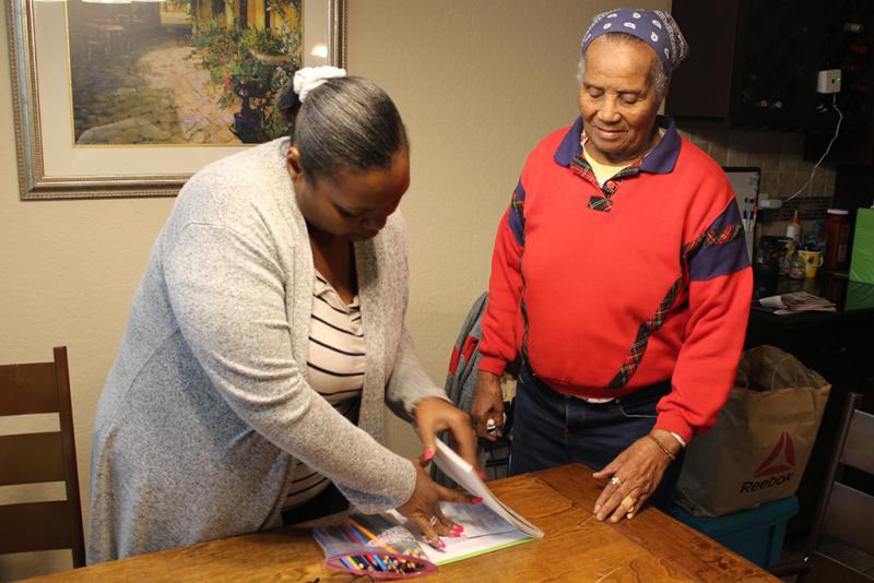At a medical foster home near San Antonio, caregiver Tiffany Graves (left) sets out art supplies for Rose Witherspoon, a World War II veteran.