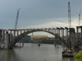 Construction cranes flank the main arch of Knoxville's Henley Street Bridge on May 22, 2013.