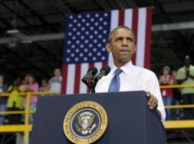 President Barack Obama pitches his middle class jobs plan to a crowd at an Amazon.com fulfillment facility in Chattanooga.