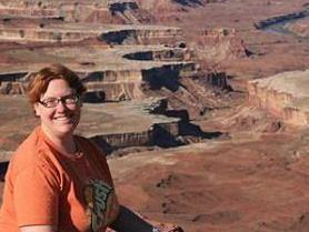 Geologist Linda Kah analyzes layered sedimentary rocks on Mars, not unlike those pictured here in Utah.