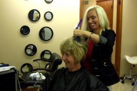 Christy Frazier-Paine, right, styles Loretta Ayer's hair. Frazier-Paine owns Salon Christy, a salon that caters especially to hearing-impaired clients.