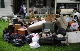 Ruined furniture sits piled outside of a Davidson County home in the wake of this week's flooding.
