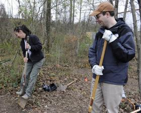 UT Anthropology graduate student Katie Corcoran (left) digs the first shovel of dirt with volunteer Devin White (right) for one of four graves at the Forensic Anthropology Center, in February of 2013. The mass grave research project will observe ten bodies for three years, detecting changes in the ground and looking at multispectral imagery. (PHOTO BY AMY SMOTHERMAN BURGESS / NEWS SENTINEL)