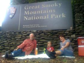 """Don and Rebecca Whittington of Montgomery, Alabama, along with granddaughter Abigail, have a """"rebellious picnic"""" at the Townsend entrance to Great Smoky Mountains National Park on Tuesday, October 1."""
